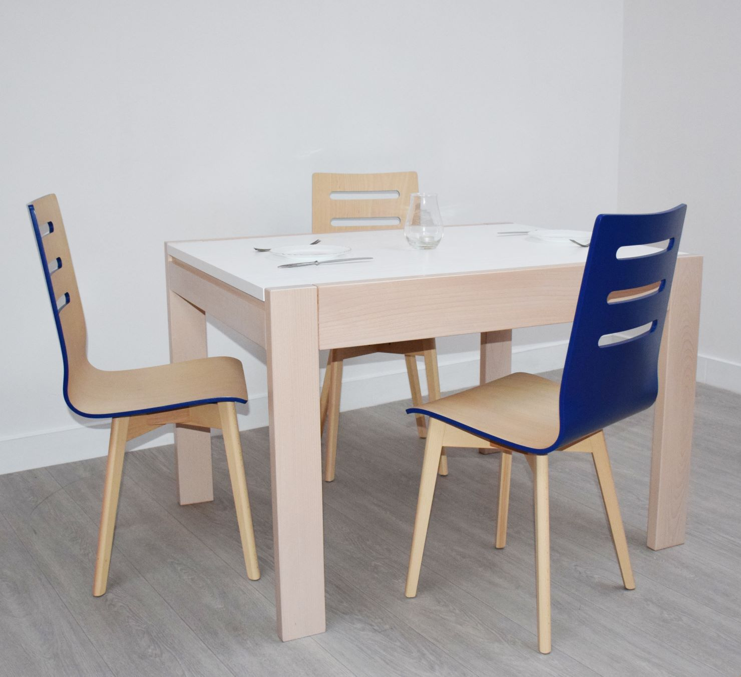 Extendable Table Neapol and Sonata (blue) Chairs from GVA Interiors
